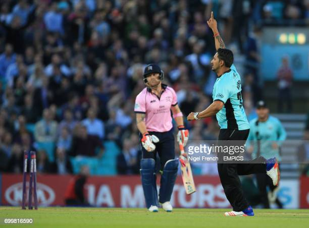 Surrey's Ravi Rampaul celebrates after taking the wicket of Middlesex's Brendon McCullum