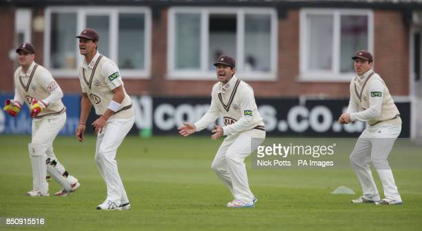 Surrey's Ricky Ponting in the slips watch a miss field with wicketkeeper Steven Davies Zander De Bruyn and Gary Wilson during the LV= County...