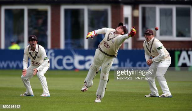 Surrey's Ricky Ponting in the slips watching wicketkeeper Steven Davies dive for the ball during the LV= County Championship Division One match at...