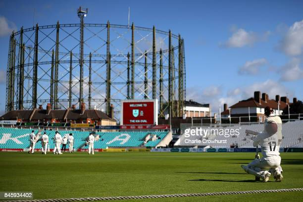 Surrey's Rory Burns and Mark Stoneman make their way out to bat during day one of the Specsavers County Championship Division One match between...
