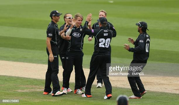 Surrey's Sam Curran celebrates with teammates for the wicket of Yorkshire's Andrew Gale for LBW