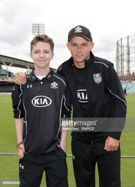 Surrey's Sam Curran poses with a fan prior to the match