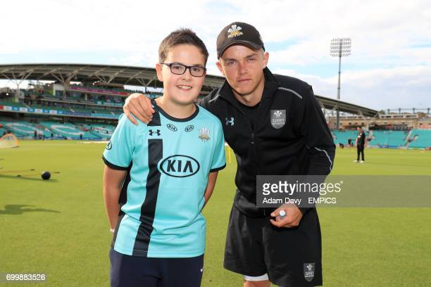 Surrey's Sam Curran poses with young mascots prior to the match