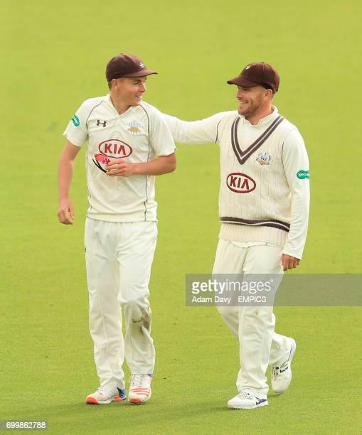 Surrey's Sam Curran speaks with teammate Aaron Finch