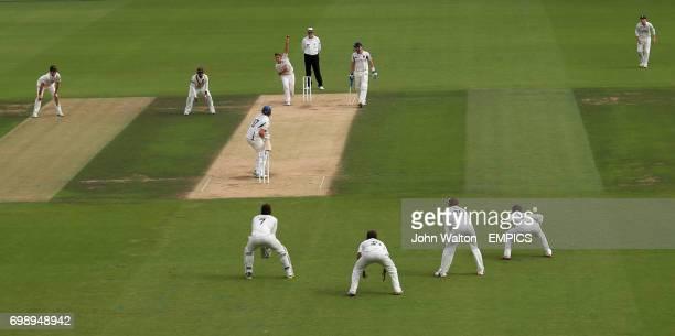 Surrey's Samuel Curran bowls to Kent's Sam Northeast