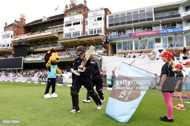 Surrey's Steven Davies and Jason Roy walk out to open the batting