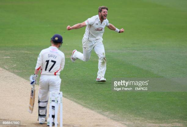 Surrey's Stuart Meaker celebrates after taking the wicket of Lancashire's Alex Davies