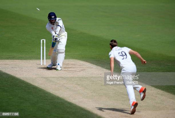 Surrey's Tom Curran bowls Gloucestershire's Liam Norwell