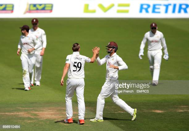 Surrey's Tom Curran celebrates after bowling Gloucestershire's Liam Norwell