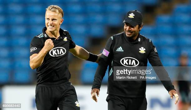 Surrey's Tom Curran celebrates taking the wicket of Yorkshire's Matthew Waite with Kumar Sangakkara during the Royal London One Day Cup Quarter Final...
