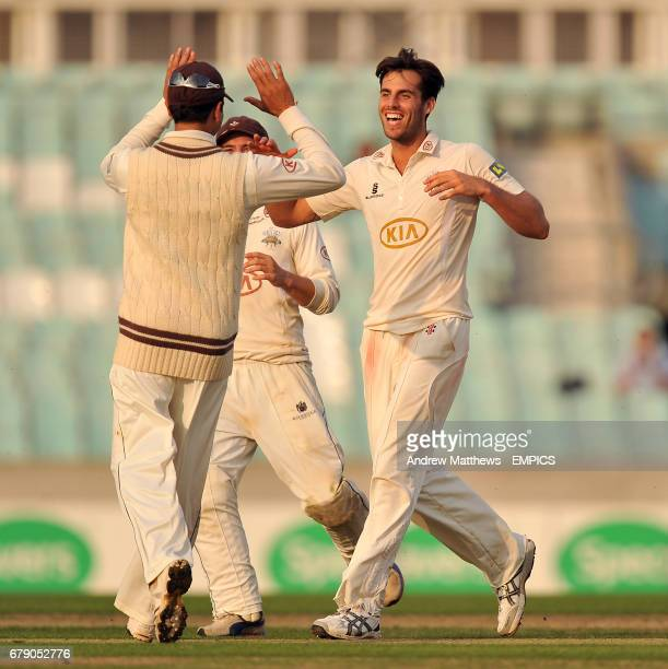 Surrey's Tom Jewell celebrates with his team mate Vikram Solanki after taking the wicket of Yorkshire's Andrew Gale