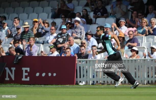 Surrey's Tom Jewell takes a catch to dismiss Chesney Hughes off the bowling of Gary Keedy