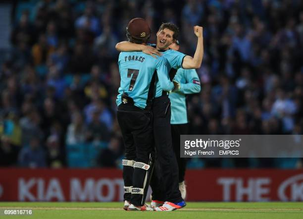 Surrey's Zafar Ansari celebrates after taking the wicket of Middlesex's Nick Gubbins
