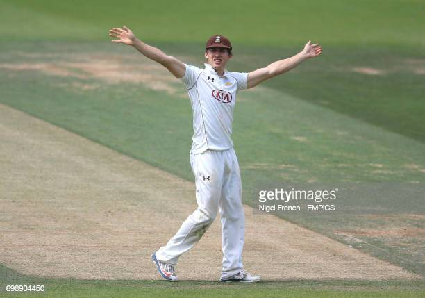 Surrey's Zafar Ansari gestures to the dressing room during the game against Gloucestershire