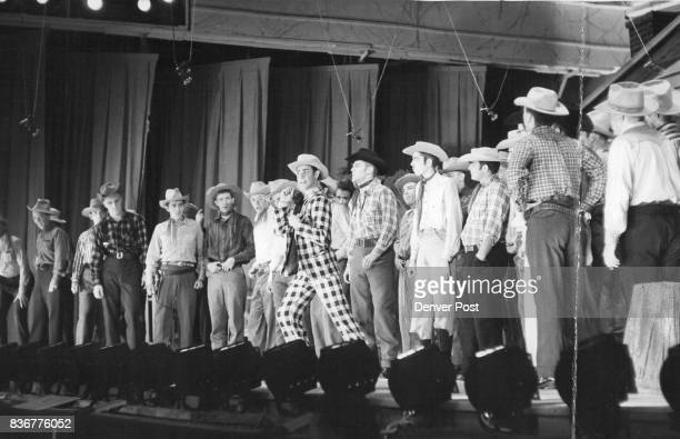 Surrounded by a male chorus as he recites his romantic woes with 'Ado Annie' is comedy star Herbert Fyler of Denver itinerant peddler who's good at...