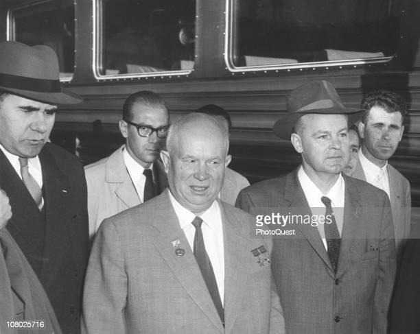 Surrounded by aides Soviet leader Nikita Khrushchev stands on a train platform while on a state visit to the United States September 15 1959