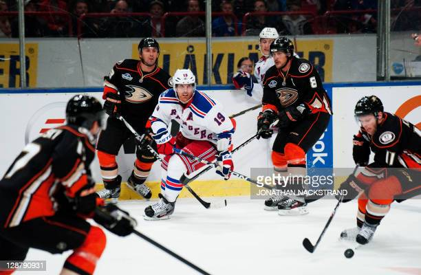 Surrounded by Anaheim Ducks's players New York Rangers's Brad Richards moves for the puck during their ice hockey NHL season game at the Globe Arena...