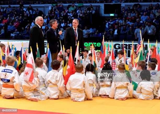 Surrounded by children the speakers at the Opening Ceremony were left to right Peter Frese President of the German Judo Federation the Mayor of...