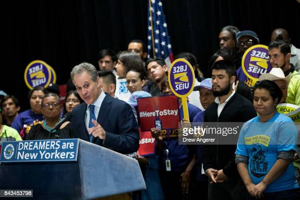 Surrounded by DACA recipients and immigration activists New York Attorney General Eric Schneiderman speaks during a press conference to announce the...