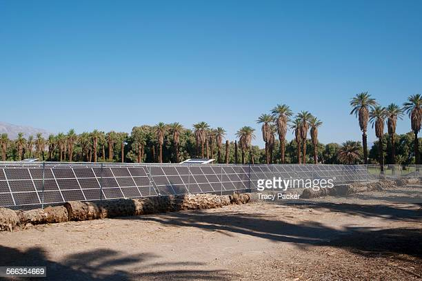 Surrounded by Date Palms and a chain link fence the 1MW Solar Photovoltaic System at Furnace Creek Resort consists of 5740 solar panels and first...
