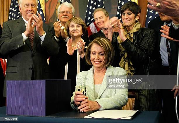 Surrounded by Democratic House members House Majority Leader Rep Steny Hoyer Rep George Miller Rep Louise Slaughter Rep Chris Van Hollen Rep Henry...