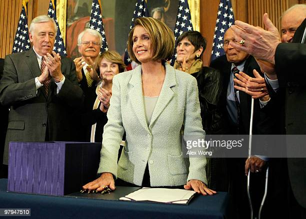 Surrounded by Democratic House members House Majority Leader Rep Steny Hoyer Rep George Miller Rep Louise Slaughter Rep Rosa DeLauro and Rep John...
