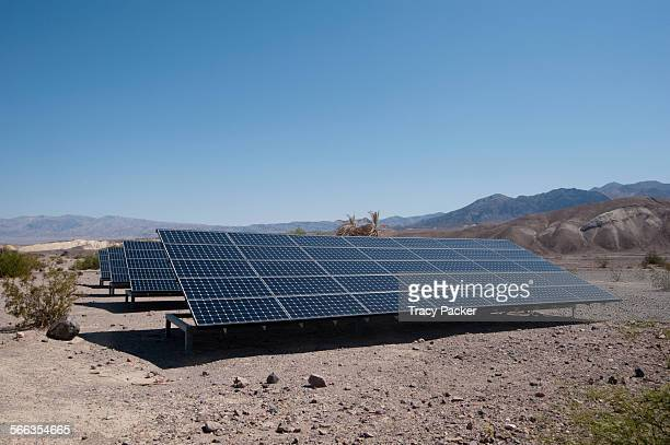 Surrounded by desert the Photovoltaic Panels behind the National Park Service Furnace Creek Visitor Centre in Death Valley contribute to making it a...