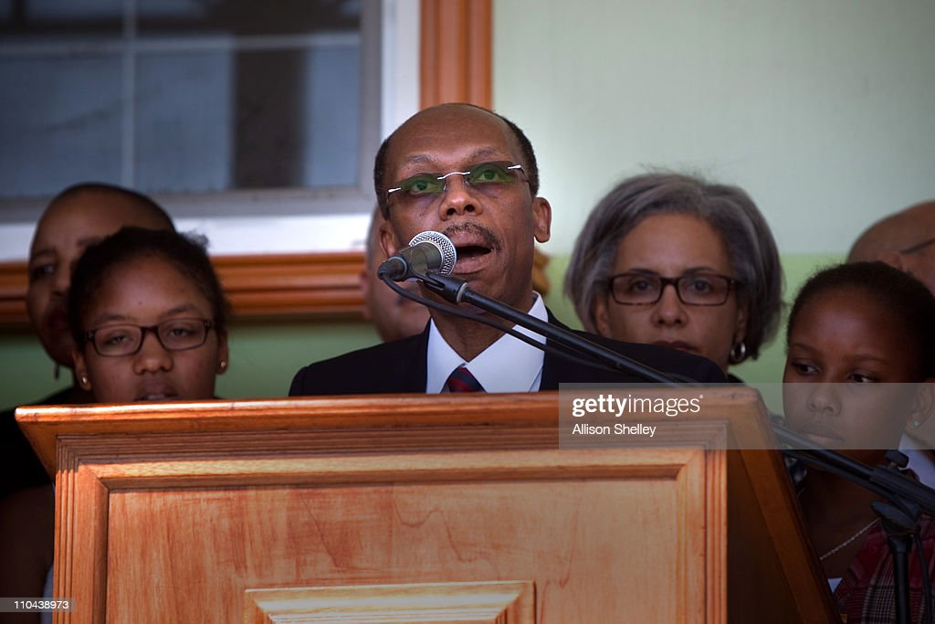 Surrounded by family and supporters, former Haitian President <a gi-track='captionPersonalityLinkClicked' href=/galleries/search?phrase=Jean-Bertrand+Aristide&family=editorial&specificpeople=176717 ng-click='$event.stopPropagation()'>Jean-Bertrand Aristide</a> speaks during a press conference after landing at the airport March 18, 2011 in Port-au-Prince, Haiti. Aristide became Haiti's first democratically elected president in 1991 and was forced into exile after being ousted in a 2004 rebellion. His return to Haiti has came just days before a crucial presidential run-off vote.