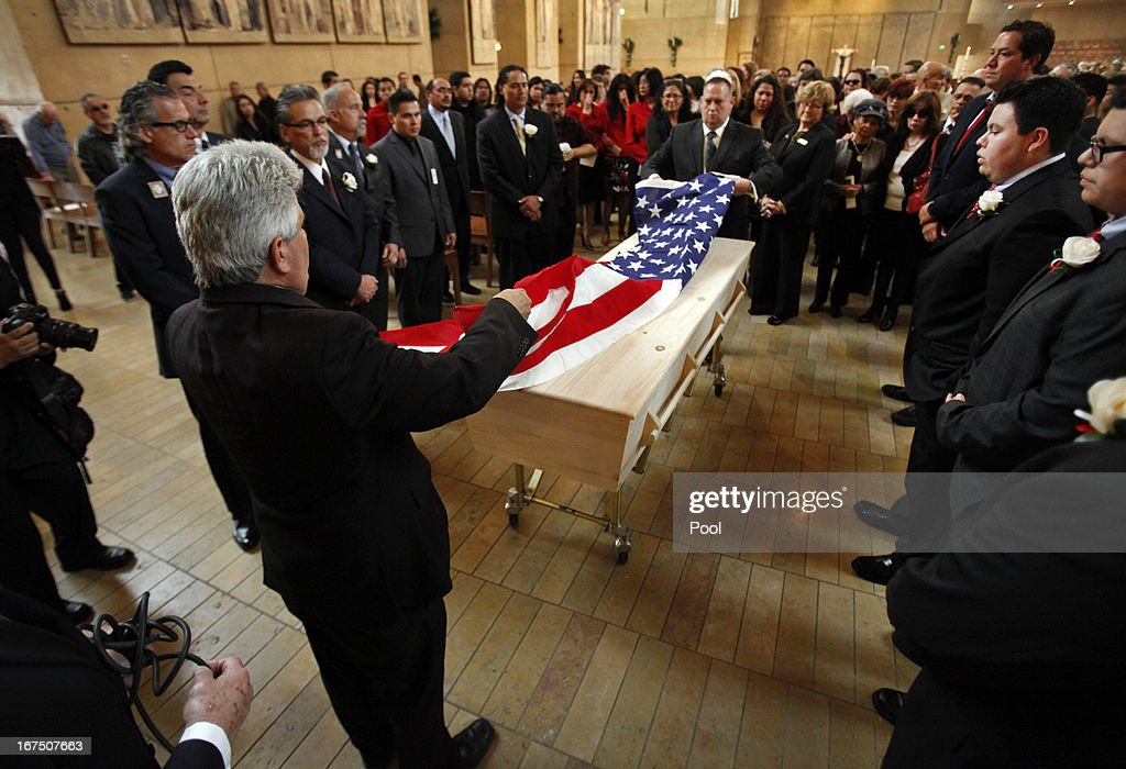 Surrounded by family the American flag is placed over the simple pine box casket of former teacher Sal Castro during the funeral mass at the Cathedral of Our Lady of Angels on April 25, 2013 in Los Angeles, California. Sal Castro was one of the leaders of the 1968 Chicano student walkouts, a protest for better schools that is considered the start of the Chicano movement.
