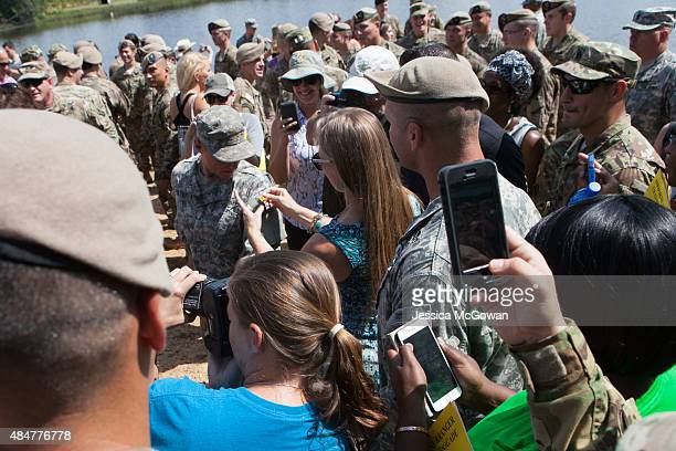 Surrounded by friends family and soldiers 1st Lt Shaye Haver is pinned with her Ranger tab at the graduation ceremony of the United States Army's...