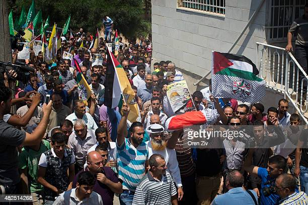 Surrounded by her relatives the body of the 18 month old baby Ali SaadDawabsheh is carried during her funeral on July 31 2015 in the Palestinian...