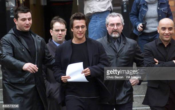 Surrounded by his minders Richard Dobson known by his stage name Ritchie Neville a member of the boy band 5ive leaving Richmond Court Dublin *...