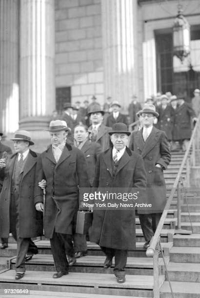 Surrounded by his retinue Daddy Browning leaves court after hearing his exchauffeur and a detective link him with Marion and Evelyn Jenis in auto...