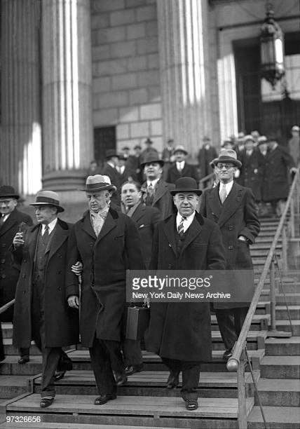 Surrounded by his retinue Edward Daddy Browning leaves court after hearing his exchauffeur and a detective link him with Marion and Evelyn Jenis in...