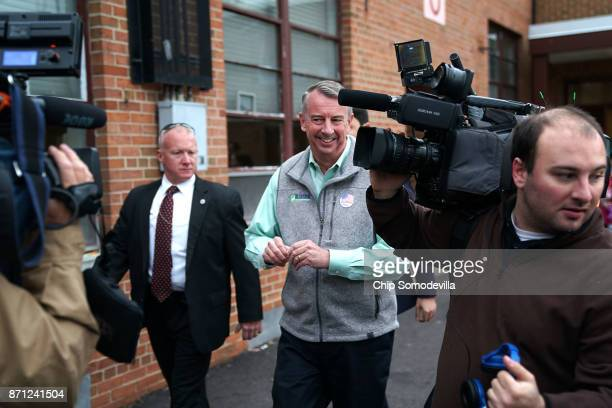 Surrounded by journalists Republican candidate for Virginia governor Ed Gillespie leaves Washington Mill Elementary School after casting his vote...