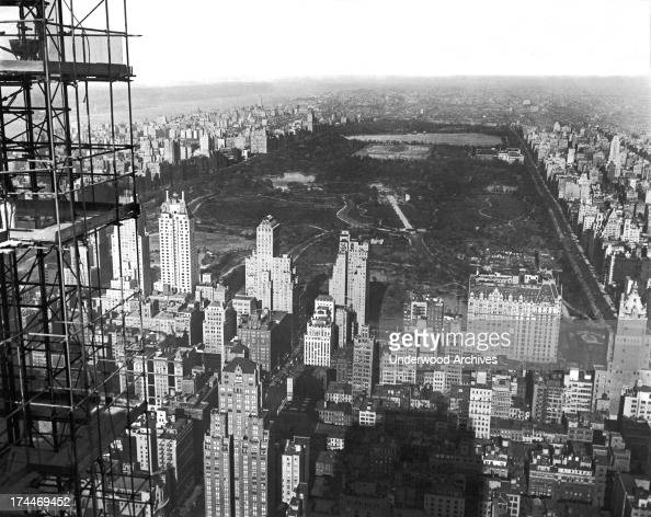 Surrounded by luxurious hotels and the buildings of a bustling Manhattan Central Park is seen from the south from the scaffolding of the under...