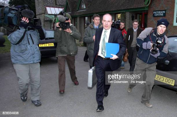 Surrounded by media Mark Oaten leaves after his surgery in Swanmore near Winchester Hampshire Friday February 3rd 2006 where he faced constituents...