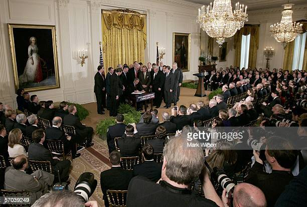 Surrounded by members of Congress and Cabinet members US President George W Bush signs the HR 3199 USA PATRIOT and Terrorism Prevention...