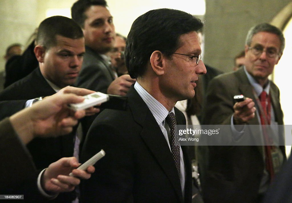 Surrounded by members of the media, U.S. House Majority Leader Rep. <a gi-track='captionPersonalityLinkClicked' href=/galleries/search?phrase=Eric+Cantor&family=editorial&specificpeople=653711 ng-click='$event.stopPropagation()'>Eric Cantor</a> (R-VA) walks back to his office from the House chamber at the Capitol October 11, 2013 on Capitol Hill in Washington, DC. On the 11th day of a U.S. Government shutdown, President Barack Obama spoke with Speaker Boehner on the phone and they agreed that they should keep talking.