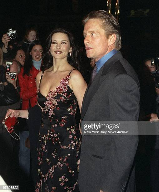 Surrounded by photographers actors Michael Douglas and bridetobe Catherine ZetaJones arrive at the Russian Tea Room for their wedding rehearsal...