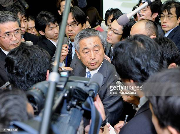 Surrounded by reporters Ichimaru Yoichiro executive vice president of Japanese auto giant Toyota Motor answers questions after a press conference in...