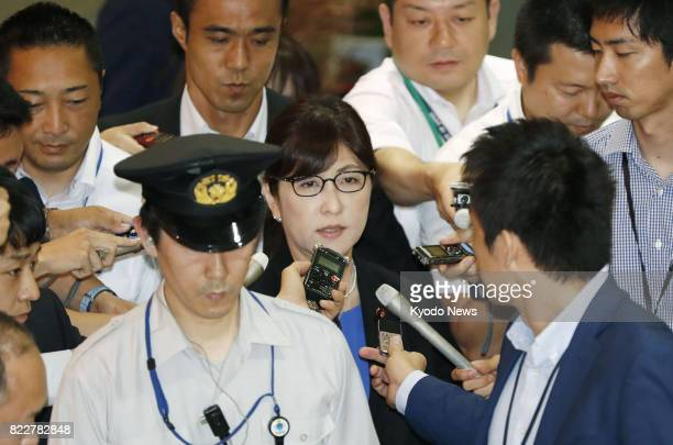 Surrounded by reporters scandaltainted Defense Minister Tomomi Inada arrives at her ministry in Tokyo on July 26 a day after she was grilled at...