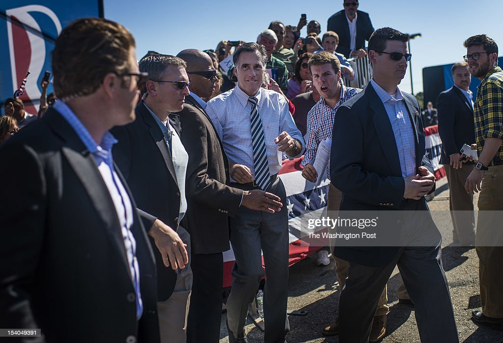 Surrounded by Secret Service and staff, Garrett Jackson, middle right, Republican nominee for President Governor Mitt Romney approaches and greets Virginia voters at a rally of 3,300 in Richmond, Virginia, Friday, October, 12, 2012.