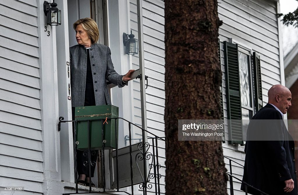 Surrounded by Secret Service Secretary Hillary Clinton visits lawmakers around the New Hampshire state capitol in Concord New Hampshire on Tuesday...