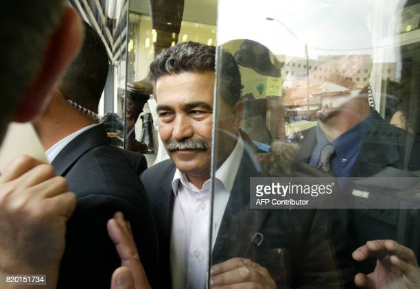 Surrounded by security Labour party leader Amir Peretz leaves a shoe shop during his election campaign tour of Jerusalem 21 March 2006 Israel's...