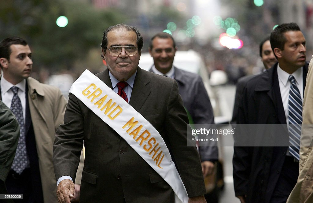 Surrounded by security Supreme Court Justice Antonin Scalia walks October 10 2005 in the annual Columbus Day Parade in New York City This is the 61st...