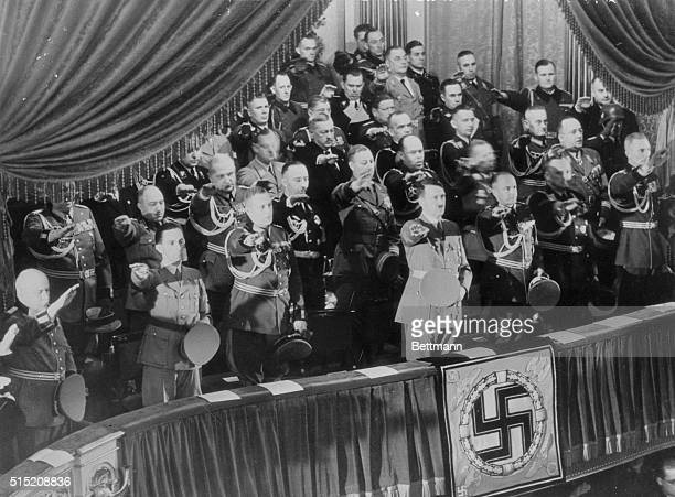 Surrounded by the key men of Nazi Germany Reichsfuehrer Adolf Hitler is shown as he saluted during the recent services on Heroes' Memorial Day at the...