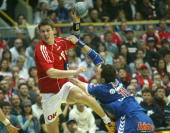 Dane Per Leegaard is fouled by Serbian Alem Toskic in a group C match in the European handball championships in Sursee 29 January 2006