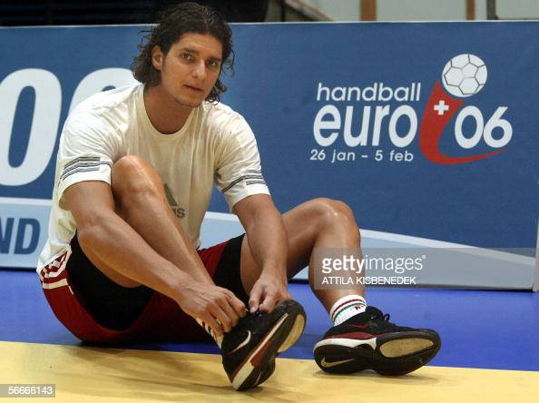 Preparing for a practice Hungarian representative and Spanish Barcelona's star Laszlo Nagy adjusts his shoelace in the local sports hall in Sursee...