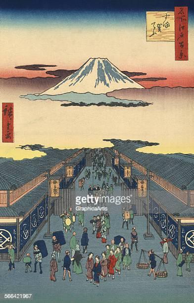 Surugacho Street in Tokyo by Ando Hiroshige ukiyoe woodblock print 1856 Print number 8 from the series Meisho Yedo Hiakkei